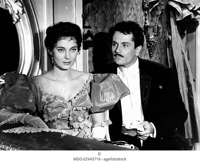 Italian actor Gabriele Ferzetti watching Swedish actress Marta Torén while they're sitting in a theatre box in Two Loves Had I... Puccini. 1953