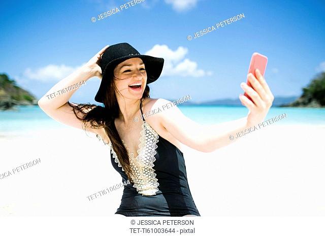 USA, Virgin Islands, Saint Thomas, Woman doing selfie on beach at sunny day