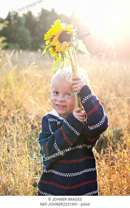 A boy with a flower