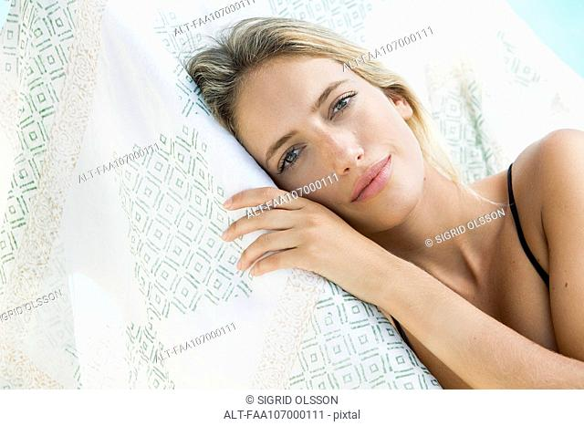 Woman relaxing outdoors, portrait