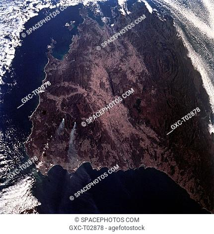 Tasmania, also known as the Apple Isle, is roughly triangular in shape and lies 150 miles 240 km south of mainland Australia