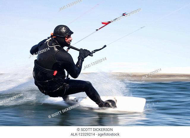 Man kitesurfing near Homer, South-central Alaska; Alaska, United States of America