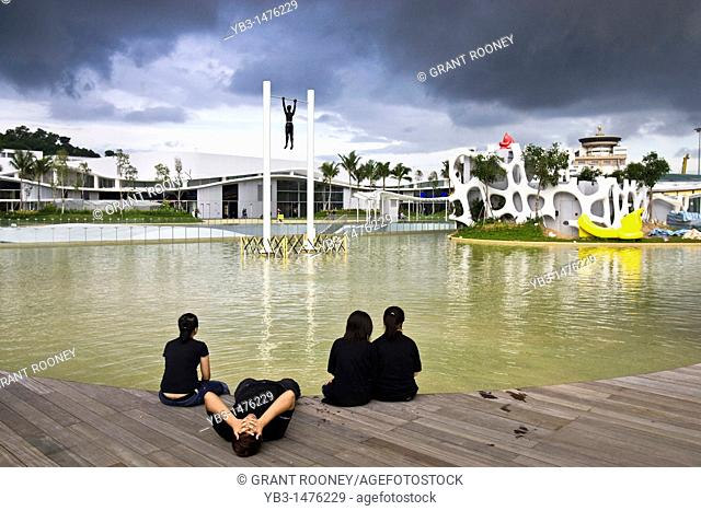 Workers relaxing by the boating Lake, Vivo City Shopping Centre, Singapore