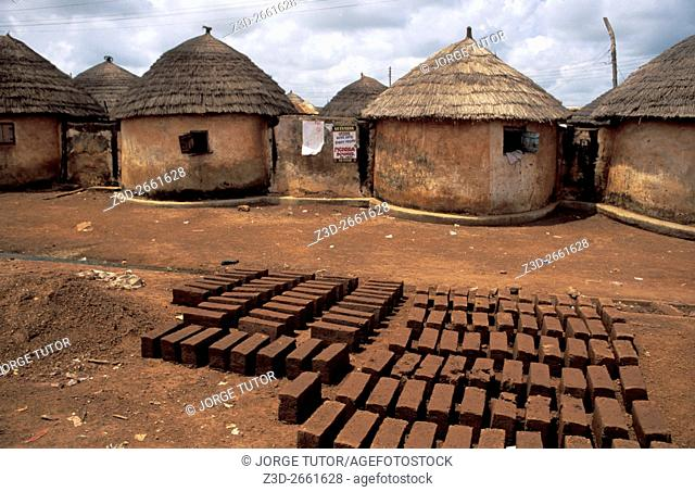 Mud bricks near Thatched Mud huts village compound in Tamale, Ghana