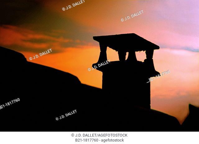 France, Aquitaine, Dordogne, chimney at sunset