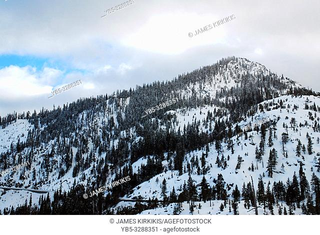 A snow covered mountain at the shore of Lake Tahoe
