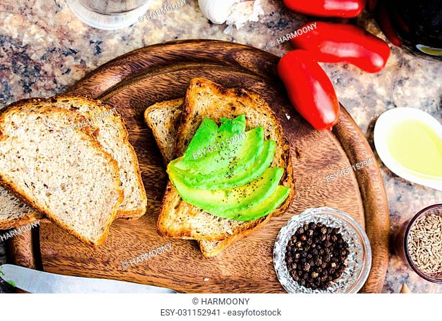 toast with fresh avocado and pepper, healthy snack, vegetarian food on a bright background