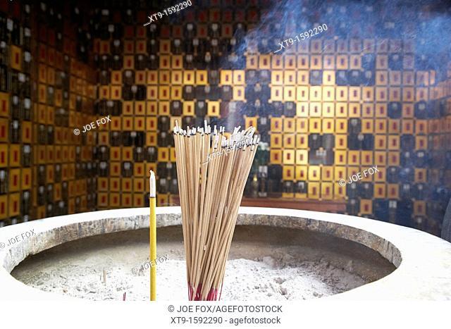 burning incense in a columbarium of po fook hill cemetery sha tin, hong kong, hksar, china