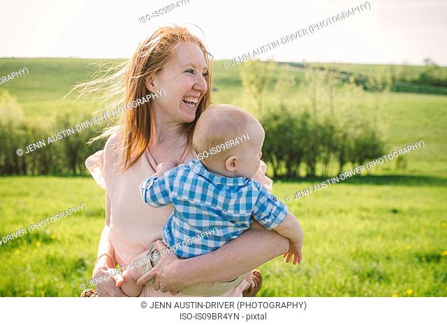 Mother and son taking walk in park
