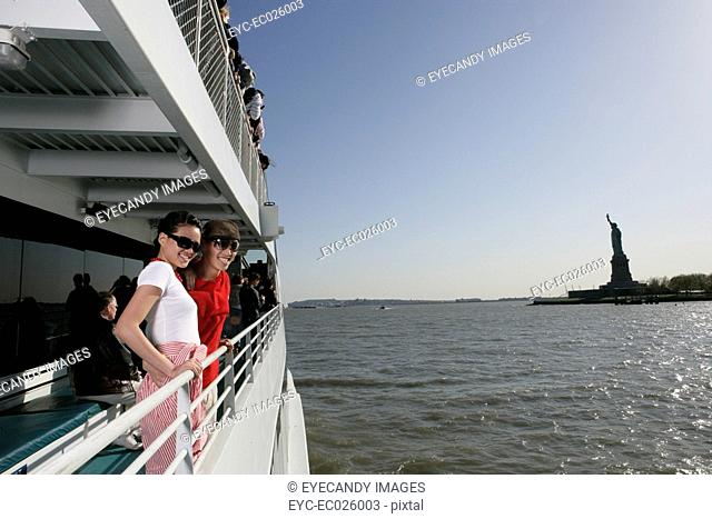 Passengers aboard a ferry in the Hudson River