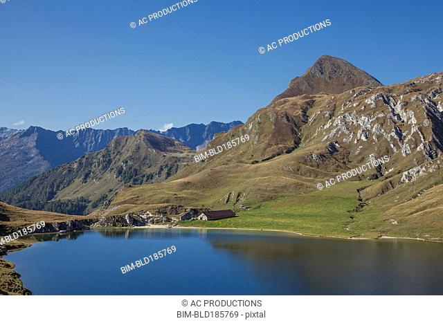 Mountains over still lake in remote landscape