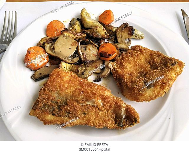 Breaded codfish with vegetables