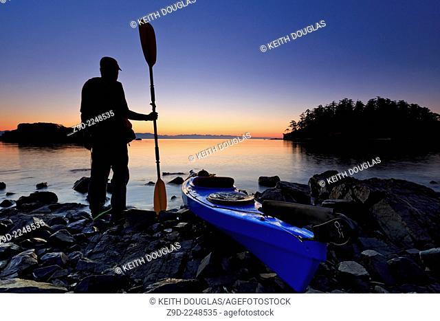 Sea kayaking at sunrise, Pipers Lagoon Park, Nanaimo, Vancouver Island, British Columbia