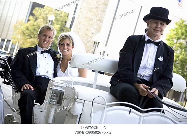Bride and groom on horse and carriage ride