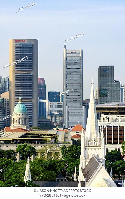 Singapore cityscape views over St. Andrews Cathedral, National Gallery and Supreme Court towards skyscrapers of the downtown core CBD