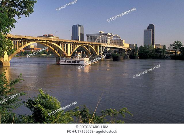 Little Rock, skyline, AR, Arkansas, A riverboat cruises under a bridge crossing the Arkansas River and a view of the downtown skyline of Little Rock
