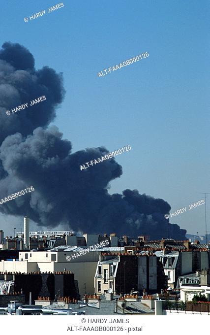 Smoke over rooftops