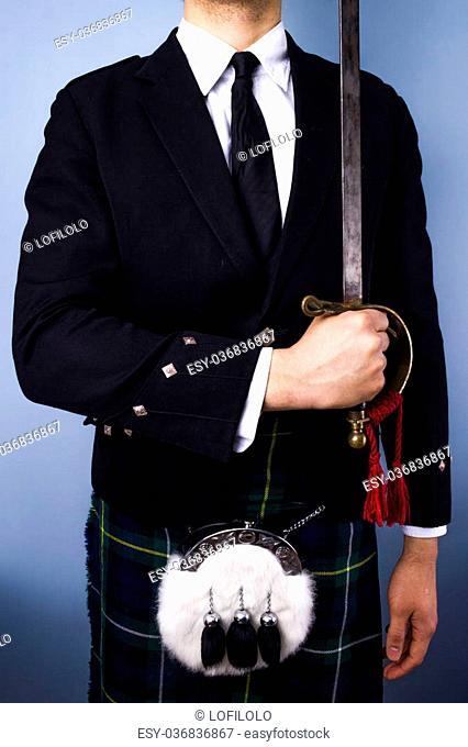 Scotsman holding sword