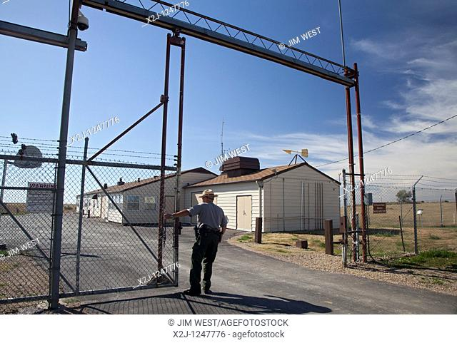Cactus Flat, South Dakota - A park ranger opens the gate to the underground launch control center for Minuteman II missiles  The site was deactivated following...