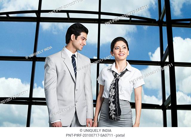 Business couple standing at an airport lounge