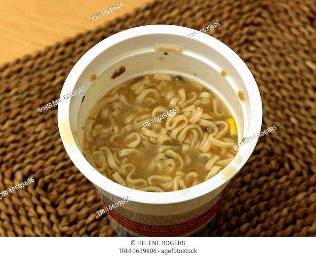 Chicken And Mushroom Instant Noodles In A Pot On A Place Mat