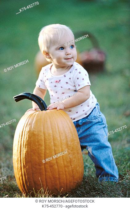 10 mouth old child with pumpkin