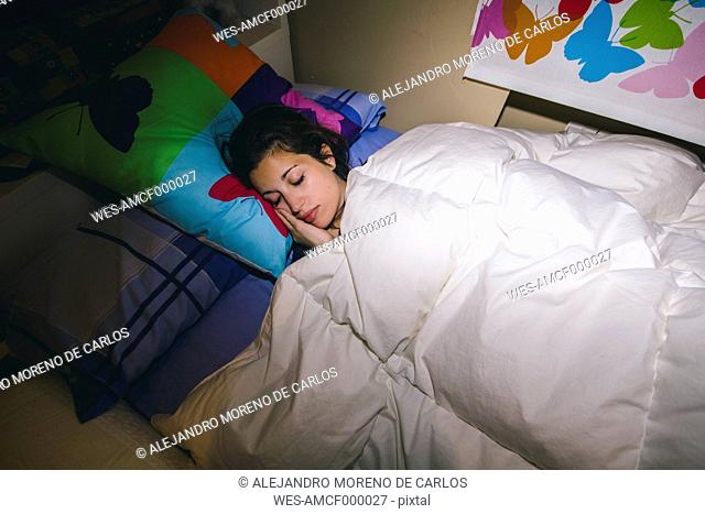 Spain, Madrid, young woman sleeping