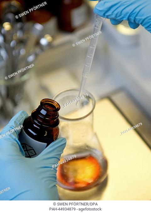 A laboratory assistant mixes various aromas for sweets in a laboratory of Symrise AG in Holzminden, Germany, 11 December 2013