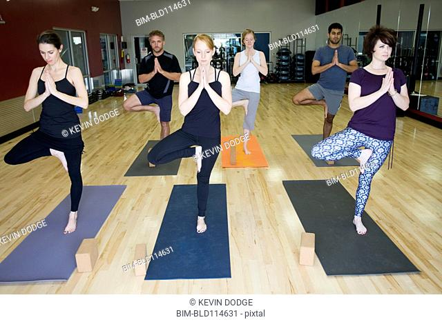 People practicing yoga in class