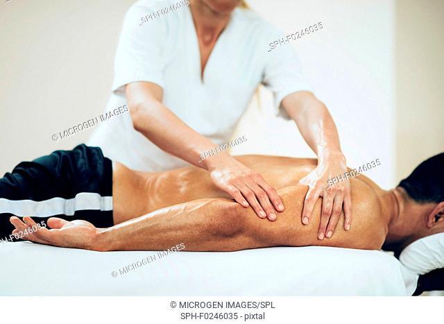 Sports massage. Physical therapist massaging man's arms