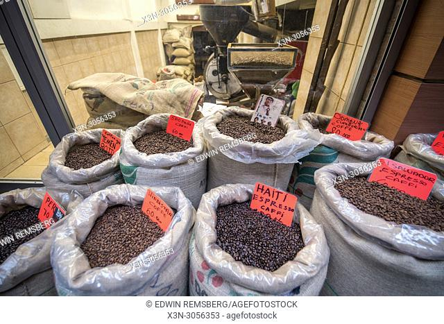 In front of a shop are linen bags filled to the brim with a variety of different blends of roasted coffee beans, Istanbul, Turkey