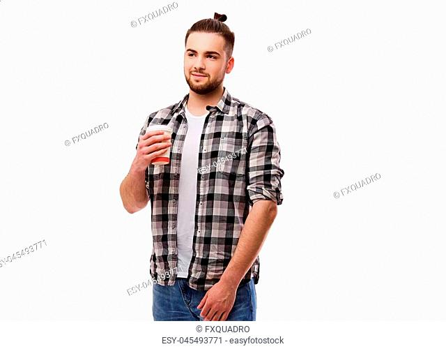 Portrait of bearded hipster male holds hot paper coffee glass isolatred on white background