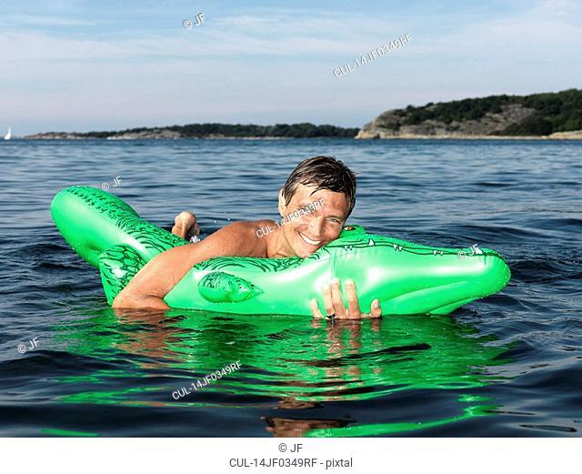 Man with inflatable crocodile