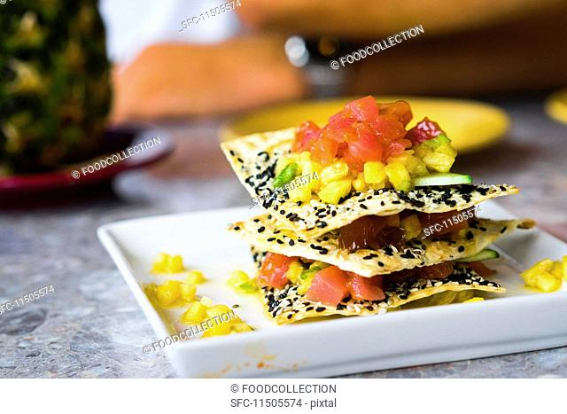 A millefeuille with sesame seed crisps, tuna fish and fruit