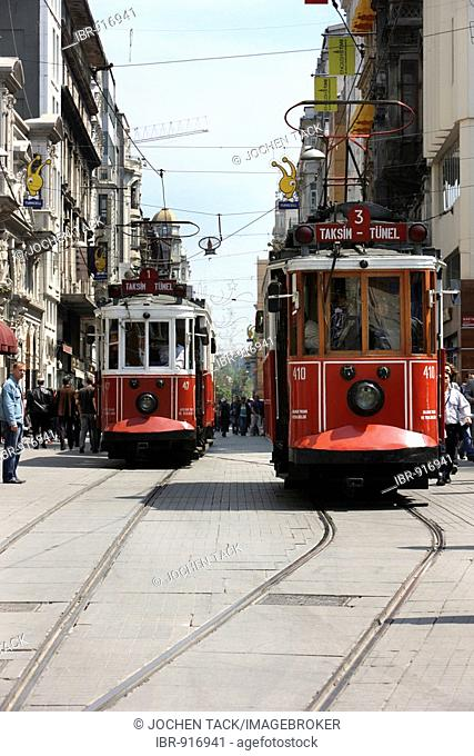 Trams passing through the main pedestrian zone, Istiklal Caddesi in the Boyoglu district, Sultanahmet, Istanbul, Turkey