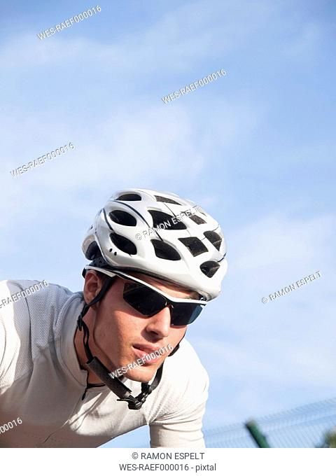Portrait of racing cyclist with cycling helmet