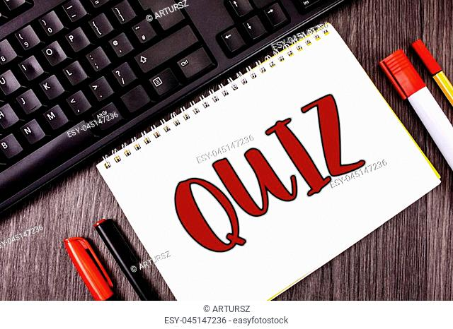 Text sign showing Quiz. Conceptual photo Short Tests Evaluation Examination to quantify your knowledge written Notepad wooden Grey background Marker and Black...
