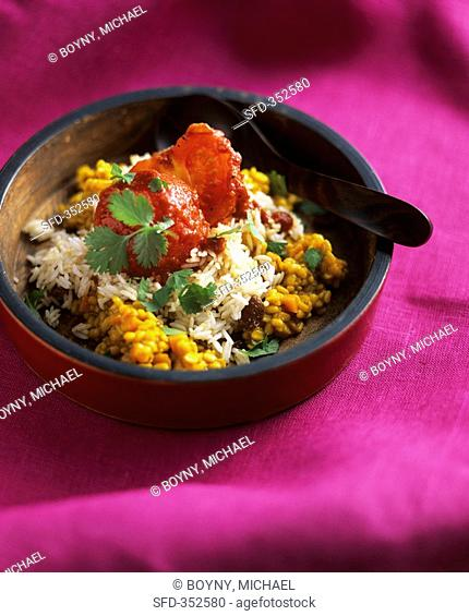 Yellow dal Indian pulse dish with raisin rice