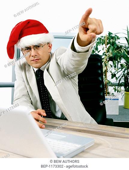 Businessman wearing santa claus cap