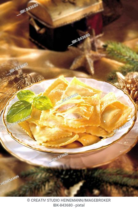 Ravioli with melted butter, table with christmas decorations