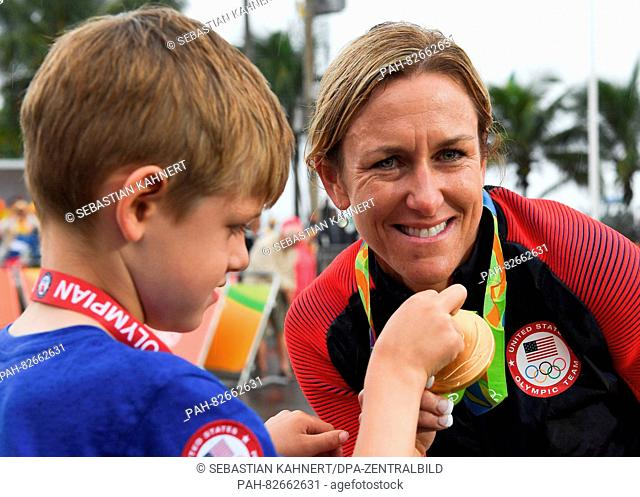 Kristin Armstrong of the USA shows the gold medal to her five year old son Lucas after winning the women's Individual Time Trial of the Rio 2016 Olympic Games...