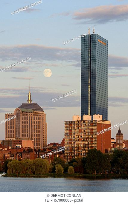 Supermoon rising over Boston and Charles river