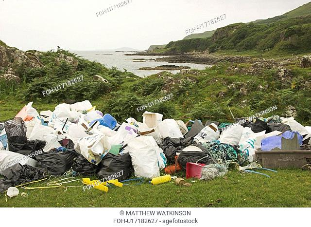 Piles of rubbish collected from beach beyond, Torloisk beach, Isle of Mull, Scotland