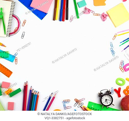 school supplies: multicolored wooden pencils, paper stickers, paper clips, pencil sharpener, copy space, back to school