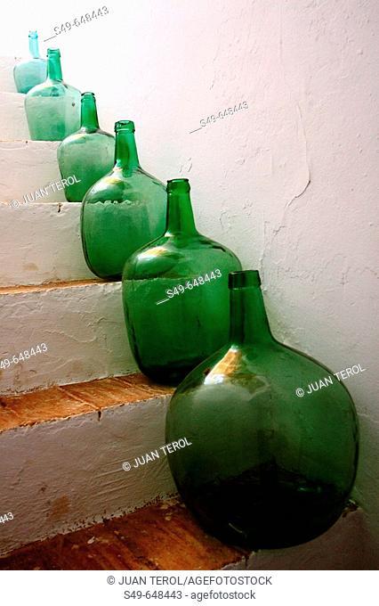 Old glass jars on steps