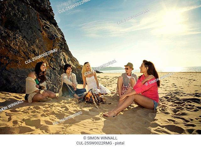 Friends relaxing on beach