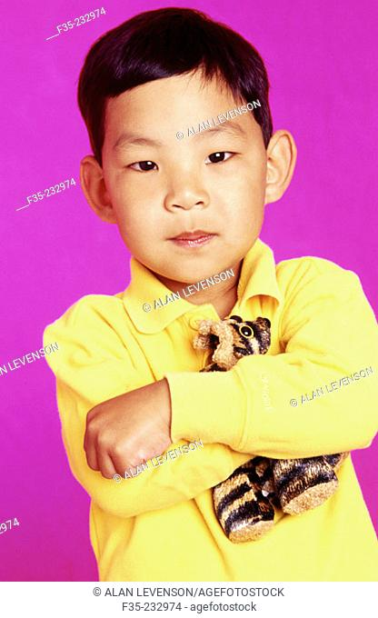 Asian American Boy Holding Stuffed Animal