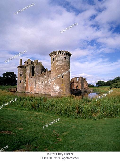 Caerlaverock Castle ruins with surrounding moat