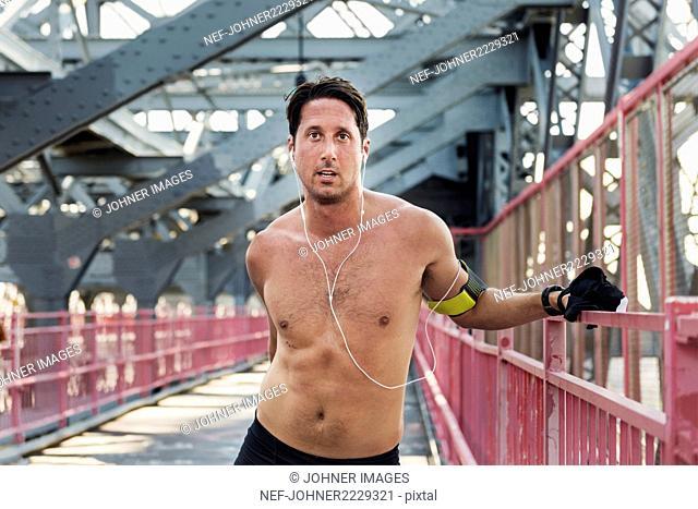 Portrait of man on bridge