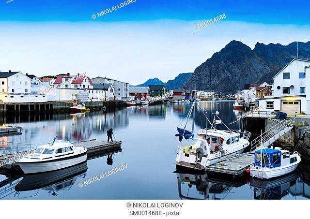 Horizontal vivid Norway town mountain quay reflections lights background backdropv
